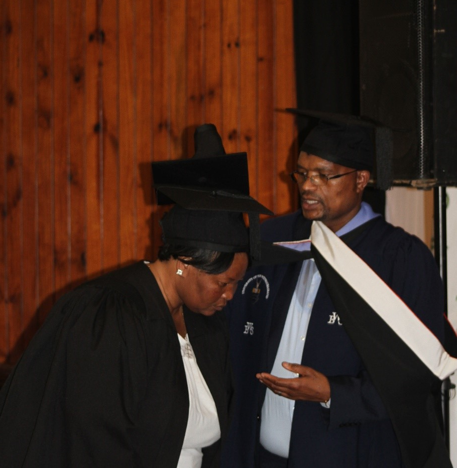 Chief Financial Officer, Mr JV Nkosi acknowledging one of the Ward Committee graduate at the ceremony.