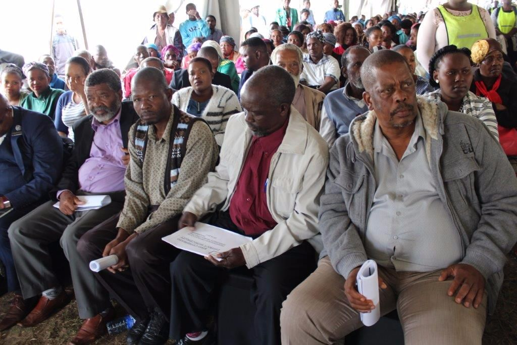 The community of uMfolozi wards 2, 7, 8, 9, 10, 11, 12, 13, 15 attentively listening to speakers at the 2017/2018 IDP and Draft Budget roadshow at the Ntuzuma Hall.